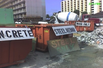 Clear signage on construction waste recycling dumpster